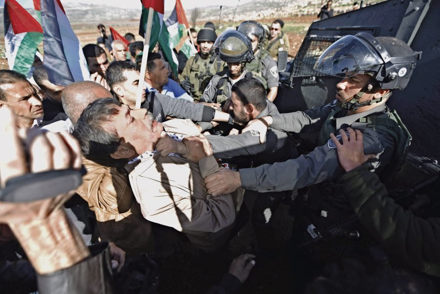 Palestinian minister Ziad Abu Ein scuffles with an Israeli border policeman near the West Bank city of Ramallah